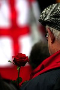 Gent holds a rose as he watches a play about St George and the dragon at the St George's Day festival at London's Covent Garden (c) Garry Knight via Flickr