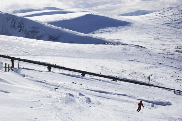 Snowy scene in the Cairngorms with lone skier