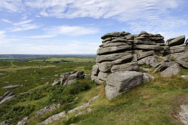 Rocky Tor in foreground and distant views across Dartmoor