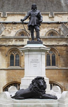 Statue of Oliver Cromwel with lion at its base