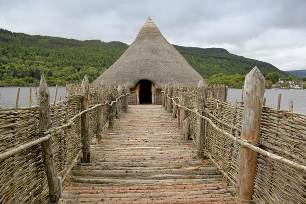 Reconstruction of iron age crannog dwelling built over the water of Loch Tay