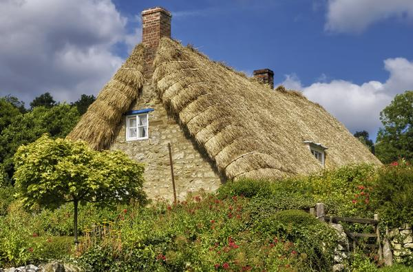 Exterior of traditional thatched cottage in countryside near Rievaulx village