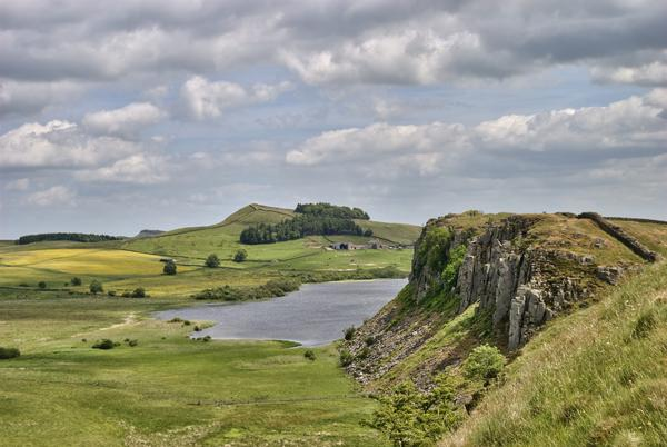 Looking along Hadrian's Wall with Crag Lough lake in the distance