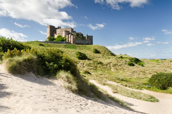 Bamburgh Castle seen from the south dunes.