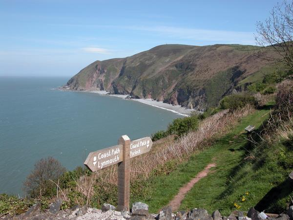 View of Foreland Point with signpost, North Devon