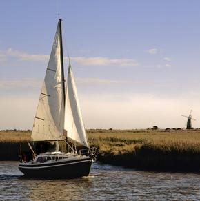 Boat sailing on the river waveney past the berny arms mill