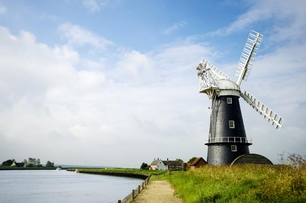 Black and white windmill on the Norfolk Broads on a sunny day