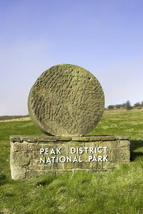 Millstone at entrance to Peak District National Park