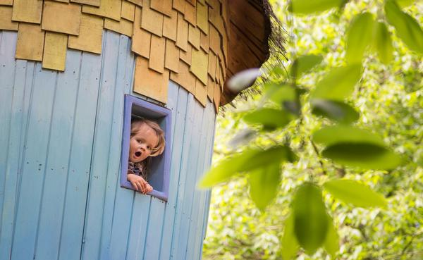 Small girl in tree house