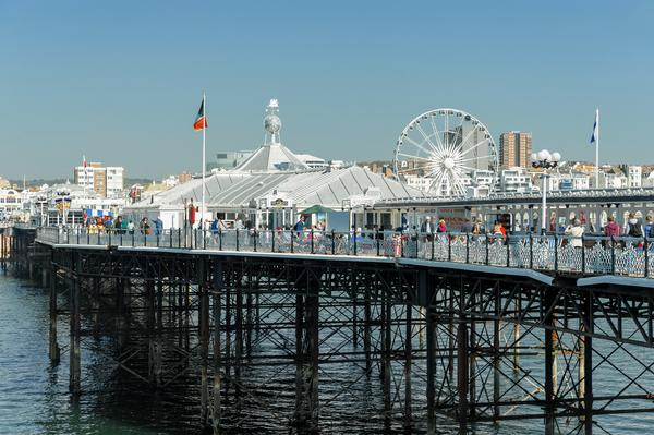 The attractions on Brighton Pier viewed from the sea end