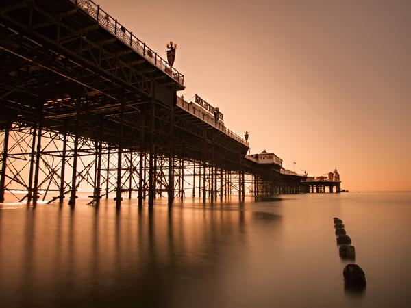Brighton Pier viewed from below at sunset