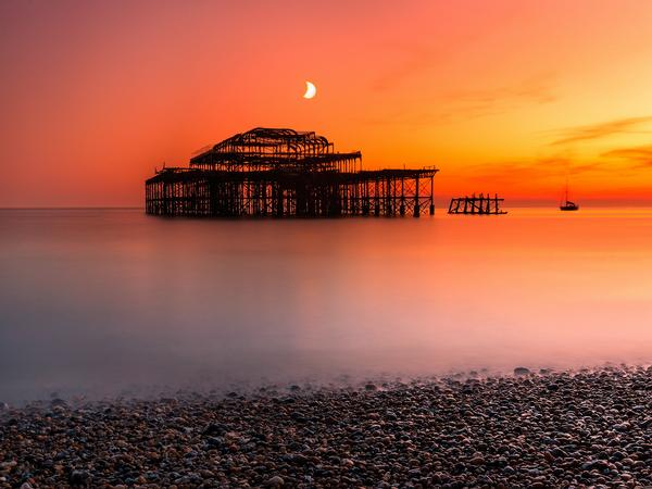 The remains of the West Pier in Brighton at twilight