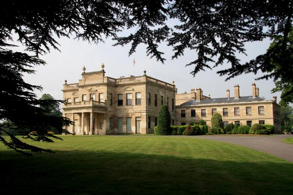 Brodsworth Hall seen framed by tree branches in the garden, was built in the 1860s