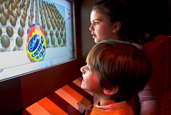 Children looking at computer screen full of Creme Eggs