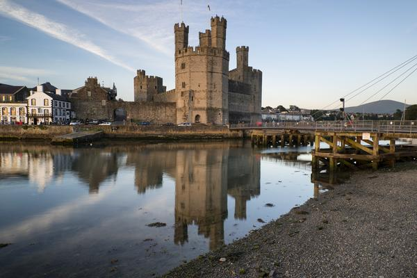 Dramatic View of Caernarvon Castle seen reflected in water