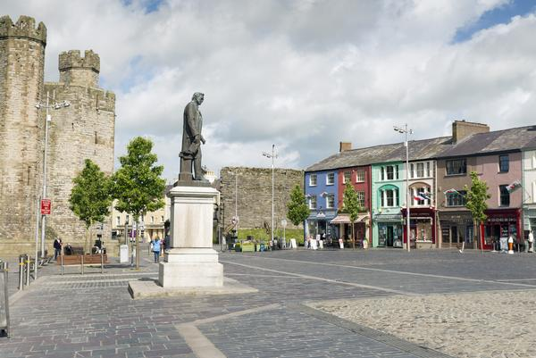 Caernarvon Castle and town square with statue