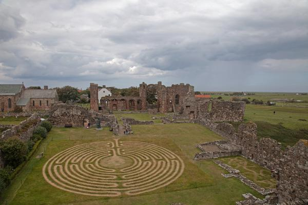 Lindisfarne Priory with maze in foreground