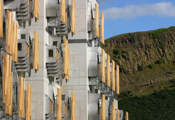 Side view of building with Salisbury Crags in background