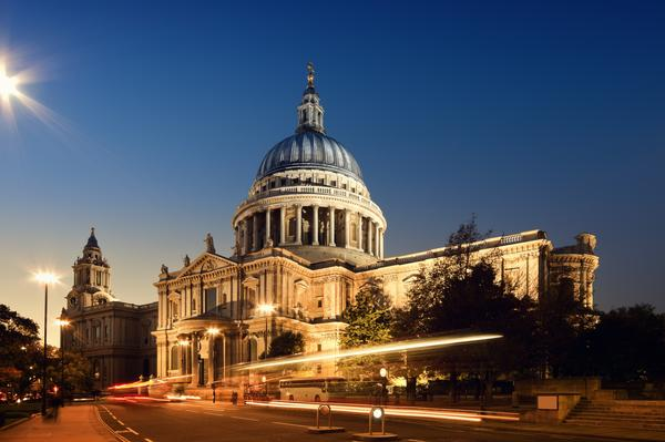 St Paul's Cathedral illuminated at night, with light trails of passing traffic