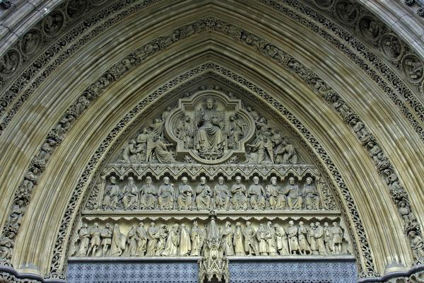 Closeup of carvings above door in Westminster Abbey