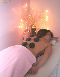 Guests having hot stone massage