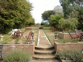 The view up the garden towards cliff path