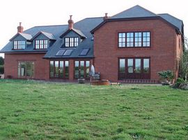Kiddicott Farm house overlooking the gardens.