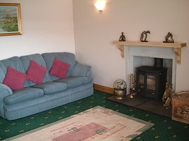 Guests lounge with woodburning stove