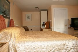 Detached room with super king size bed.