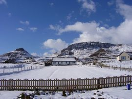 winter scene from B & B with cottages & Quira