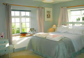 Peaceful bedrooms hung with Rosie's paintings