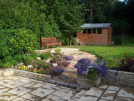The garden opening onto woodlands