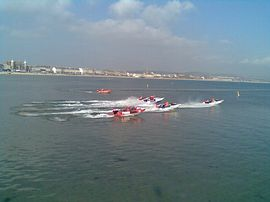 Powerboats race in front of Aaran House