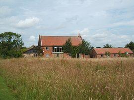 Frogs Hall Barn overlooking meadows