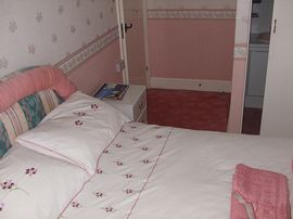 Pink bedroom with shower