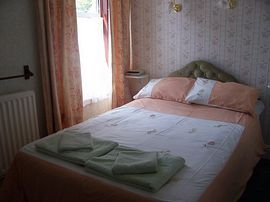 Green bedroom with shower
