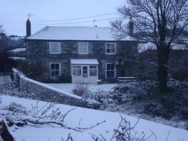 Farm house in the snow