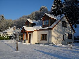 Tummel Lodge in the snow