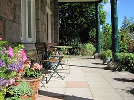 Guests can sit out on the large verandah.