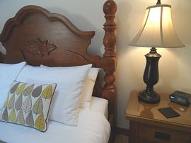 The Hayloft room with bedside tables and lamp