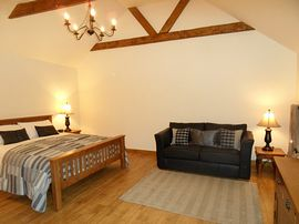 The Cowshed room with high ceilings and oak k