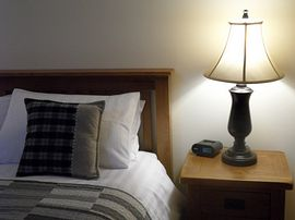 Comfortable king size bed in The Cowshed room