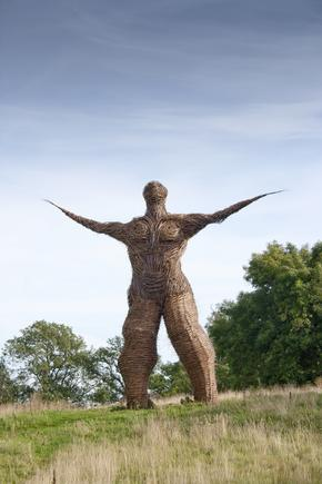Looking towards wickerman willow sculpture at Archeolink in Aberdeenshire, Scotland, UK