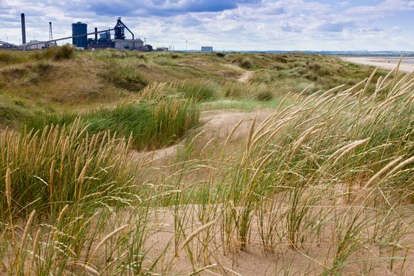 Redcar steel blast furnace viewed from the sand dunes
