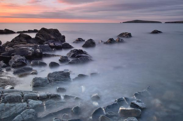 Misty sea on rocks, looking towards Cardigan Island from Poppit Sands Beach St Dogmaels