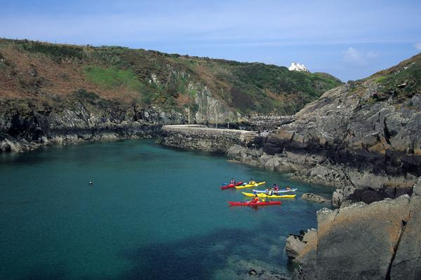 A group of canoeists on the sea at Porth Clais, Pembrokeshire