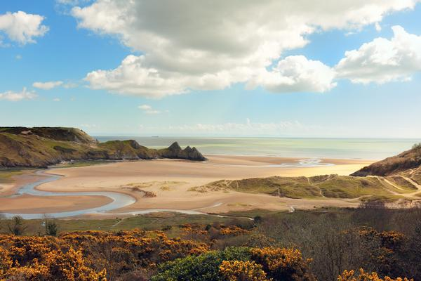 A view of Three Cliffs Bay on a sunny day in the Gower Peninsula in South Wales