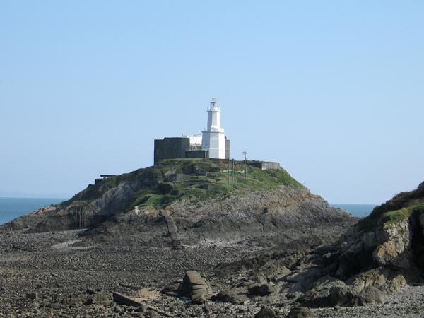 Mumbles Lighthouse, situated on a large rock, Swansea, South Wales,