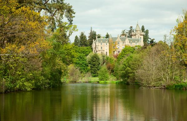 Scots Baronial mansion Blair Drummond House seen from across the lake