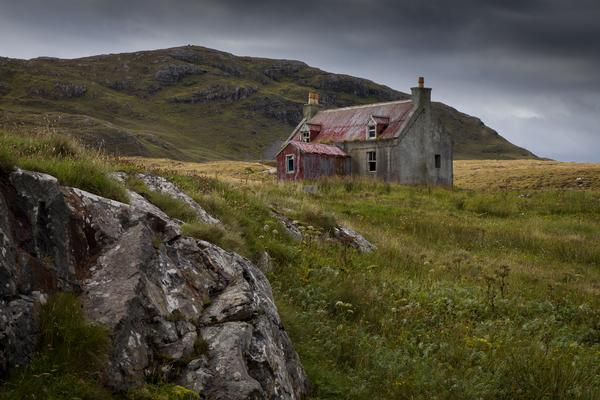 An old abandoned cottage on a hillside in Eriskay, Western Isles